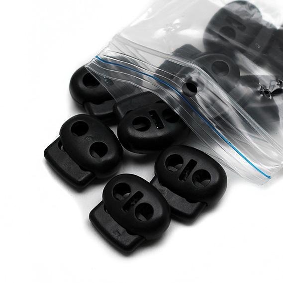 Brzdička oválná plastová dvoudírková pr.5mm, 20ks/bal černá (cena / kus)